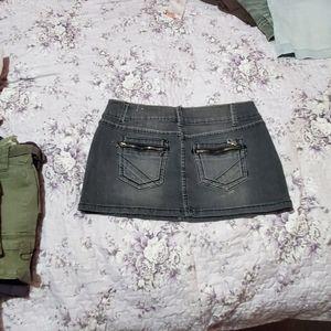 6 pairs of gently used mini denim skirts.